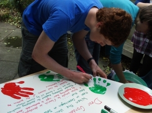 Joe adding his name to the climate justice campaign petition