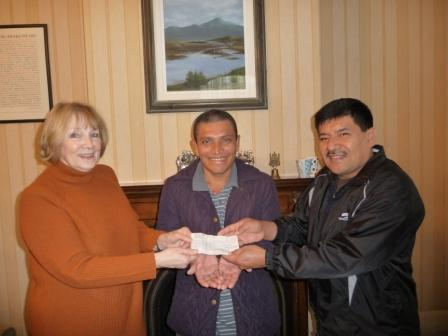 Pat Pugh presenting cheque on behalf of Our lady of Lourdes Parish to Fidel and Erasmo for  Connect2 El Salvador