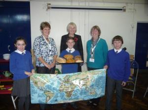 L-R Angela, Diane Robertson (Head) and Lesley with Yr 6 pupils