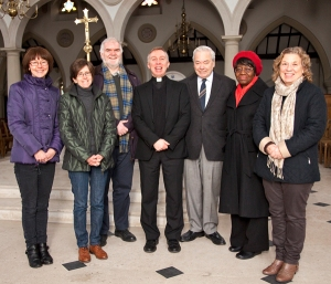 Fr Martin Boland (centre) with the Livesimply team together with the two assessors, Fr Chris and Odun Ogundipe