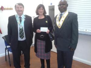 CAFOD Joint Diocesan Manager Joanna Jarvis receveing a cheque from Chris Fitzgerald, Treasurer and Grand Night Tony Boahene
