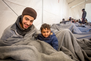 brothers-keep-warm-under-blankets-as-they-wait-at-the-border-credit-cafod-natalia-tsoukala
