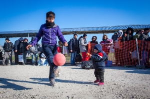 refugee-children-play-whilst-waiting-at-the-border-credit-cafod-natalia-tsoukala